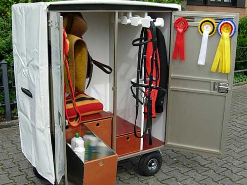 Mobile saddle cabinet with protective cover
