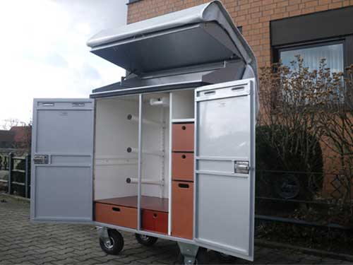 Saddle cabinet with ceiling attachment and cover